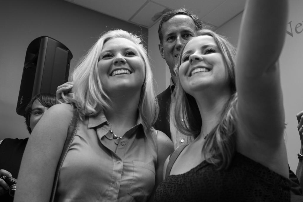 "<a href=""/images/rick-santorum-presidential-selfie-girls"">Own this image</a>"